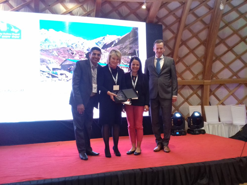 Trish and Murari on stage in Ulan Baator receiving the 2018 UIAA Mountain Protection Award