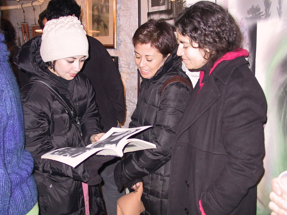 guests looking at my book at art video screening  Jan 03.JPG