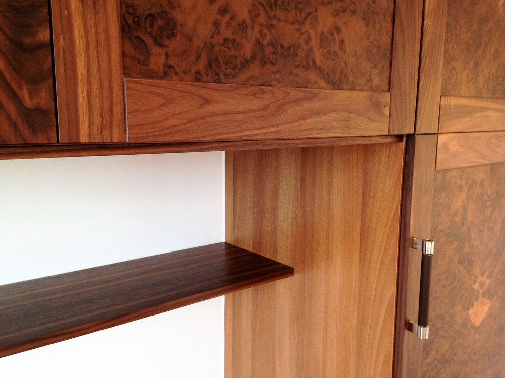 Bedroom wardrobes in black walnut and walnut burr