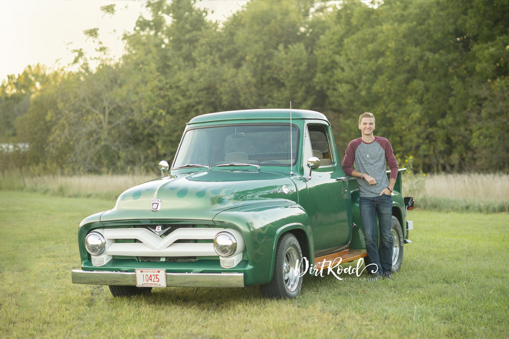 dirt-road-photography-wilber-nebraska-clatonia-lake-southeast-photographer-senior-farm-grass-sunshine-sunflare-sunset-guy-boy-senior-high-school-wilber-southeast-nebraska-photgrapher-photography-green-grass-classic-custom-muscle-truck-car-ford-green-custom-paint-flames