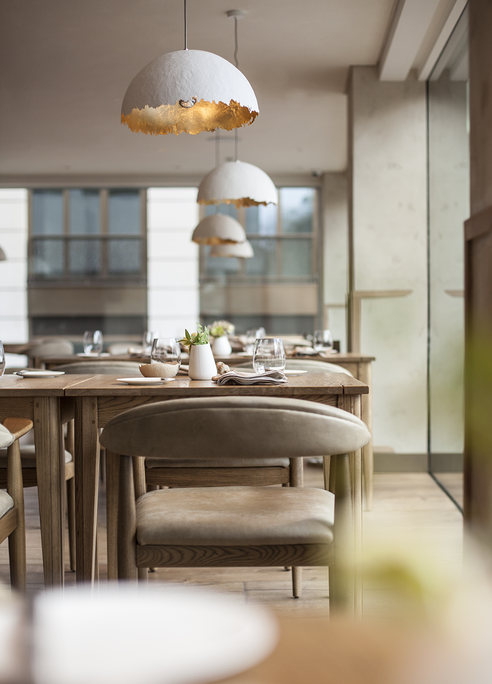 Tables and Chairs at Above restaurant offer parkside views at this prime location overlooking Green Park