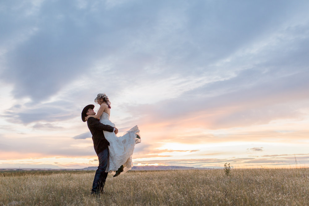 The most spectacular sunset was the perfect end to Charla and Dalton's wedding day in Lagrage, Wyoming last summer. Their entire wedding day was the picture of western romance see more here:  https://www.wyomingweddingphotographer.com/megan-lee-photography/charla-dalton-wyoming-ranch-wedding