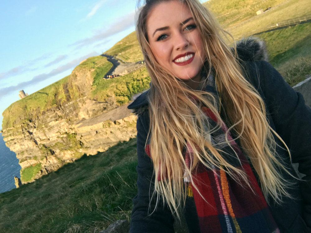 I'm not exempt from this theory in the slightest!I love to post travel photos to Instagram and now I've decided to travel blog. One of my top liked photos of 2016 was this selfie at the Cliffs of Moher.