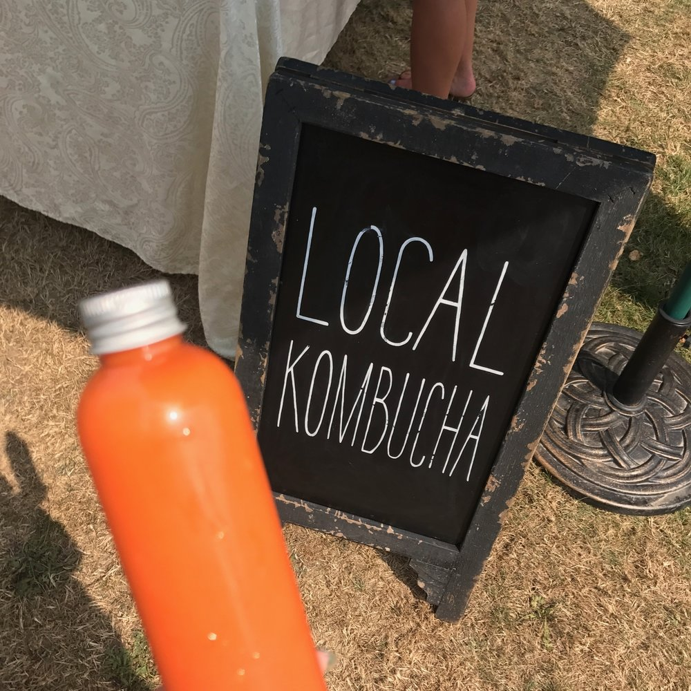 """Although the farmers market is seriously lacking vegan baked goods, you can't go wrong with local kombucha. Tumeric & ginger """"welness shot"""" pictured here."""