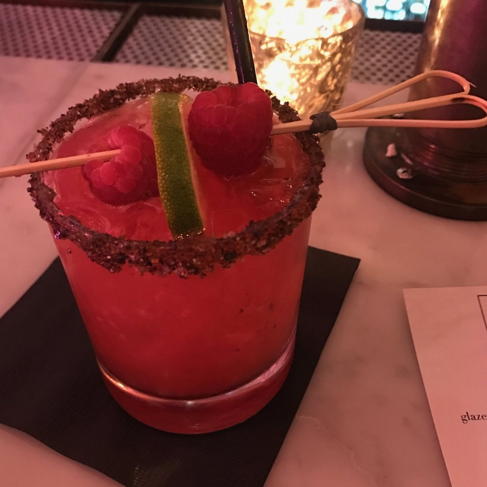 This lovely drink was not on the menu but was a bartender recommendation based on a few questions she asked me about my taste. It is a raspberry margarita with a spicy and salty rim. It was unreal.
