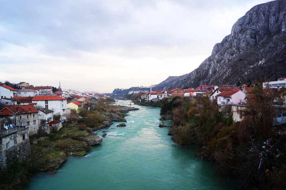 The Naretva River runs turquoise and cleaves Mostar in two.