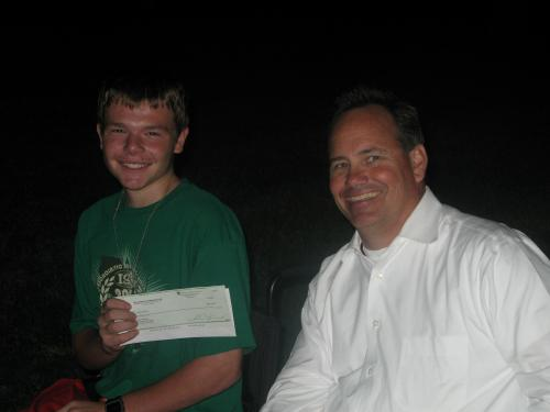 Joey receiving a check from Eric and Head North