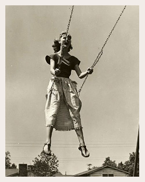 woman on swing with border.jpg