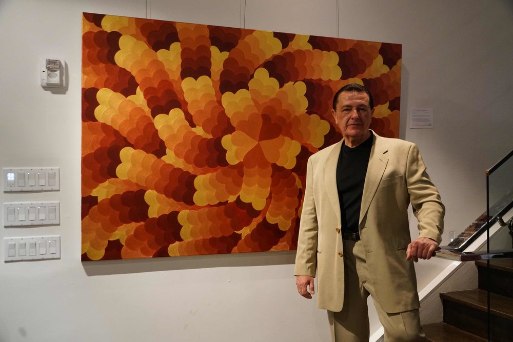 """Vladimir Nazarov in front of his painting """"The Throne Our Bodies Built"""""""
