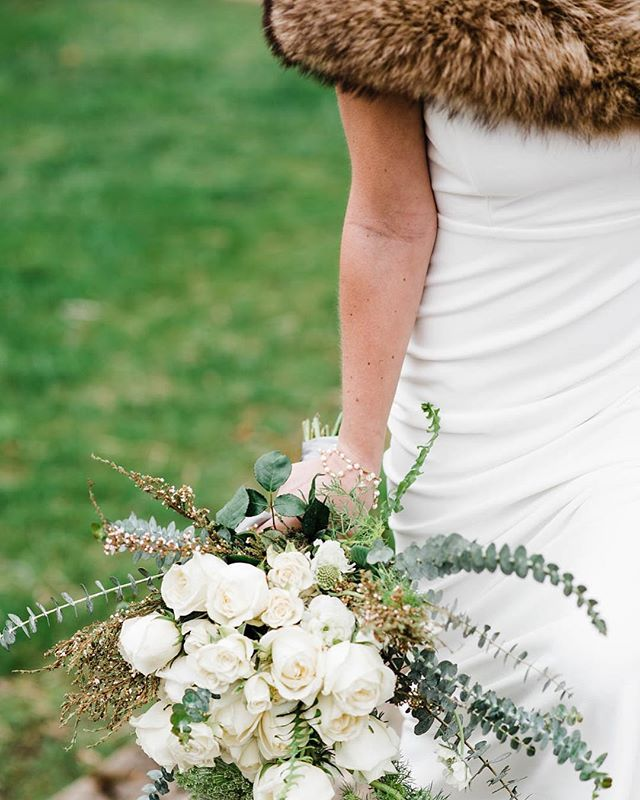 Baby it's cold outside . What better way to add a little fun, a little texture, and a little warmth to a Winter wedding, than faux fur! I️ mean look at that simple white dress POP! . Seriously, ALL THE HEART EYES! . Photography @jenretteromberg Venue @kellumvalleyfarm  Planner @camdengrayweddings Stationary @tigerlilyinvitations