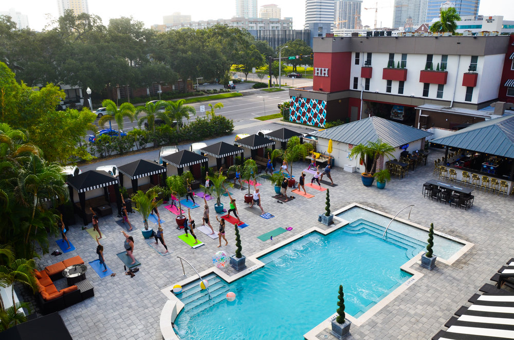 Aerial view of the Hollander Hotel pool area during an exercise class