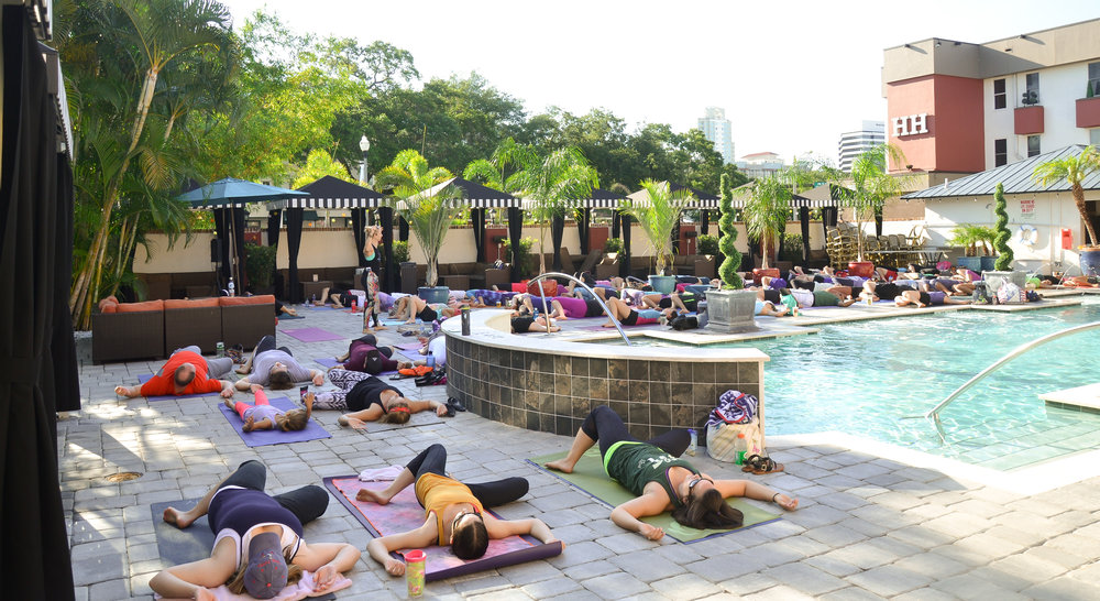 Yoga class in the pool area during the day