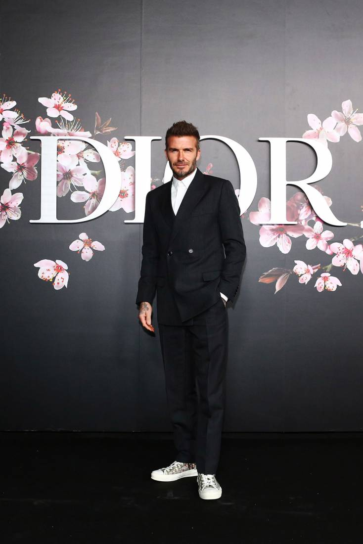 David Beckham has been leading the mens fashion game since he first came onto the soccer field in 1996. Beckham sat front row at his fashion designer wife's NY Fashion Week runway show in February. The retired soccer star wore a tailored to perfection black suit and Christian Louboutin shoes. He attended the event of the year, The royal wedding in May with his wife, Victoria wearing a three piece, charcoal grey Dior Homme morning suit. He continued to showcase that Dior is his go to designer when it comes to well tailored suits, and sat front row at their menswear show, rocking the brand head to toe. -