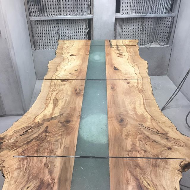 One of our newest designs being finished in the finishing room! #liveedgetable #woodworking #design #maple #diningtable #functionalart #wood #table #resin #nofilter  #westcoast