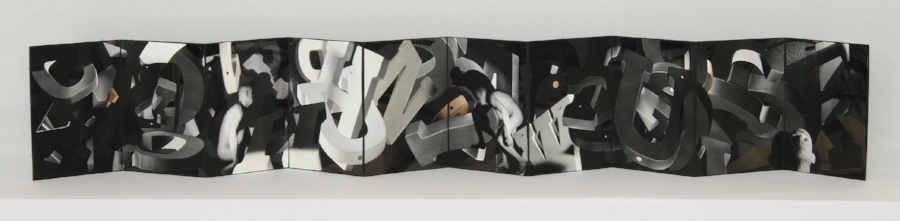 "Mixed media artist's book by Cynthia Laureen Vogt: Listening to Darkness, 2016, 5"" x 3.625"", unfolds to 43.5"" length."