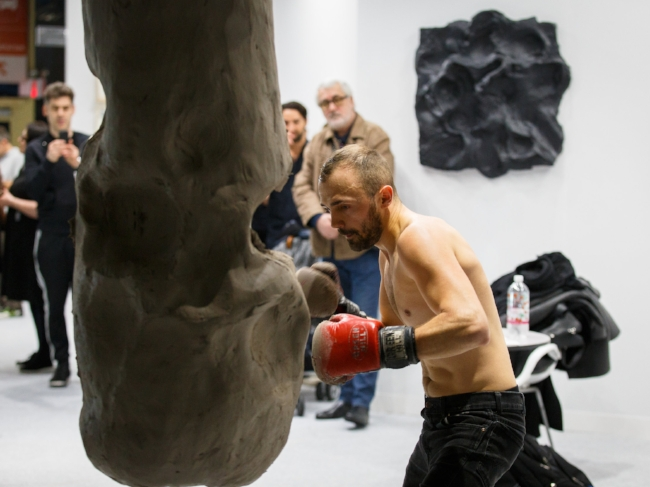 Szilard Gaspar performs Full Contact Matter for the preview crowd (exhibited by Zorzini Gallery, Bucharest)