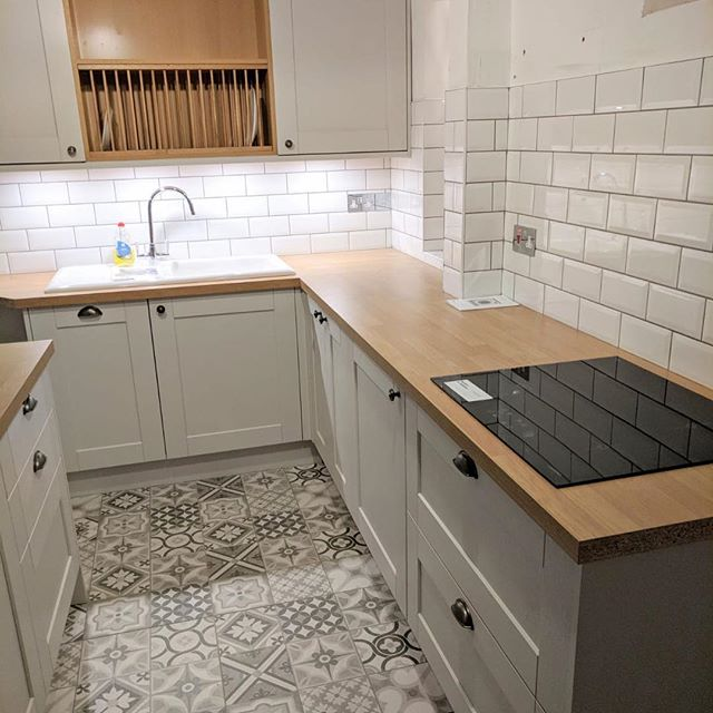 A recently completed kitchen installation with floor and wall tiling by @l.gtiling