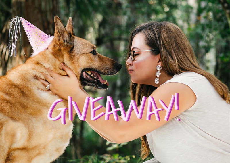 Image of a woman and her puppy advertising a giveaway being hosted by Eola Pets and Samgold Photography