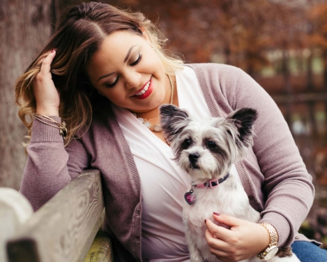 Outdoor image of a woman and her puppy taken by Orlando Pet Photography