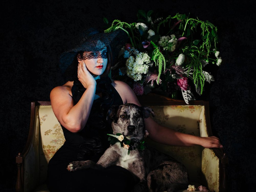 Studio portrait of a woman and her dog Penny surrounded by beautiful flowers taken by Orlando Pet Photography.jpg