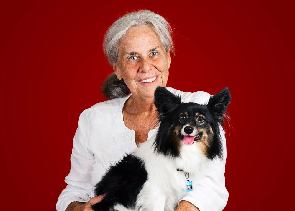 Studio-image-of-a-woman-and-her-Papillon-taken-by-Orlando-Pet-Photography.jpg