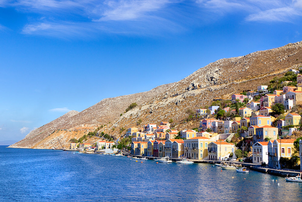 HOUSES ALONG THE HARBOUR • Symi