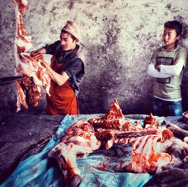 Butcher working at market day in Necha, Solu. The one day in the week that villagers will have meat from buffalo, goat and pork. #food #meat #solu #nepal #butcher #veg #market #flavoursofnepal