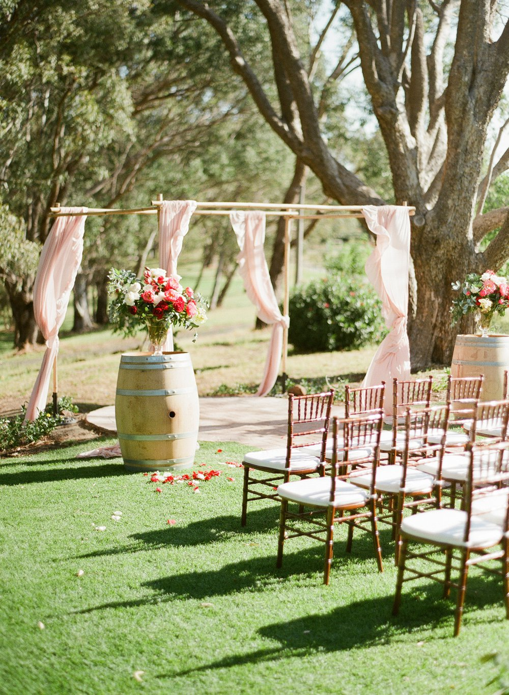 Elegant wedding ceremony at Mandoon Estate with our Bamboo Canopy and tiffany chairs