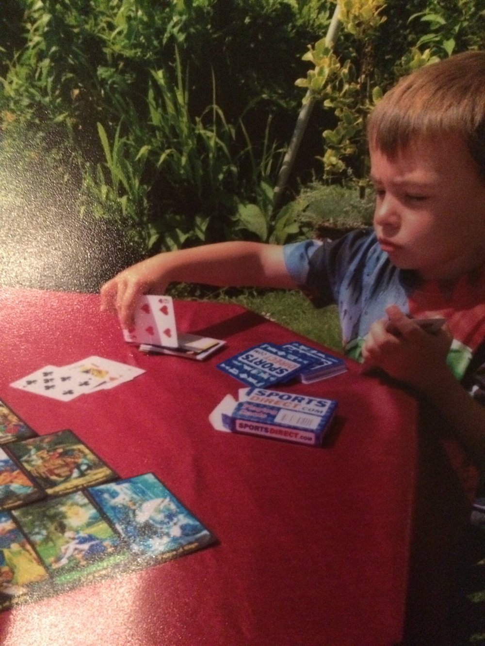 This is a picture of my nephew learning fortune telling as a child a couple of years back. In Gypsy culture, men generally don't practice divination or tarot but he was curious so I started teaching him some beginners techniques.
