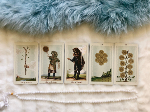 Ace of Wands. Page of Pentacles, King Swords, 7 of Pentacles and 9 of Pentacles