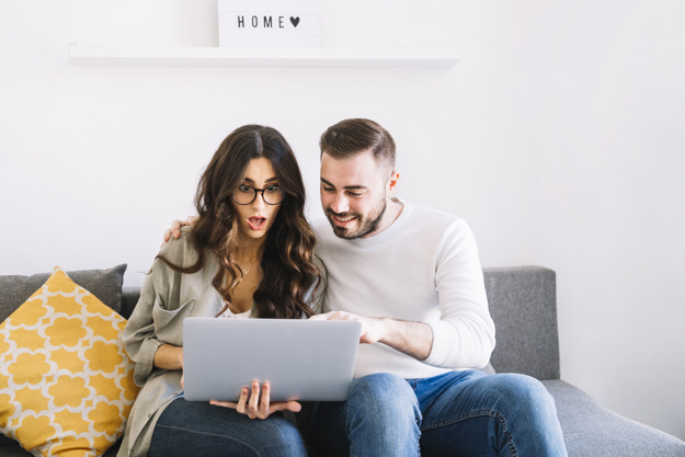 excited-couple-using-laptop_23-2147766957.jpg
