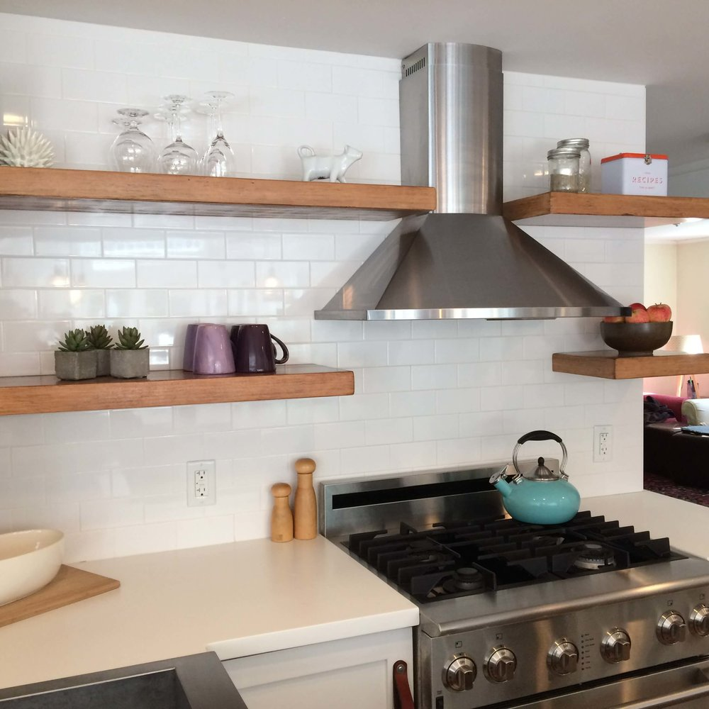 modern hood with white subway tiles