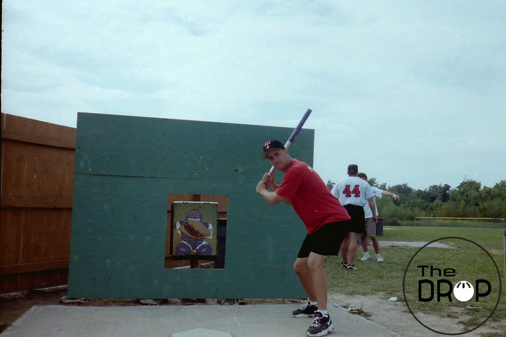 Mike Palinczar poses in front of the Hole strike zone at the 1997 North American Championships in Cincinnati. Notice the original Johnny target strike zone set up behind the window