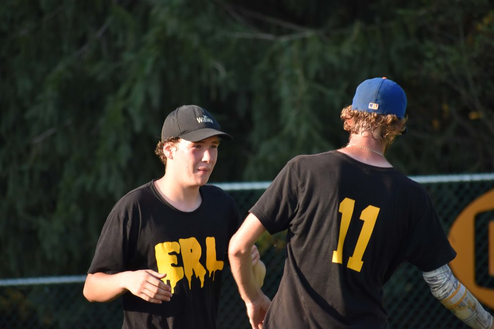 Joe Schlindwein (left) and Connor Young (right) celebrate their tournament win at  Backyard Brawl  seconds after the final out was recorded.