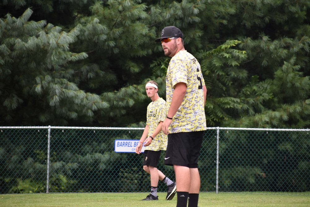 The Lemon Heads' Matt Cripse gets ready to deliver a pitch while teammate Tim Beck looks on.