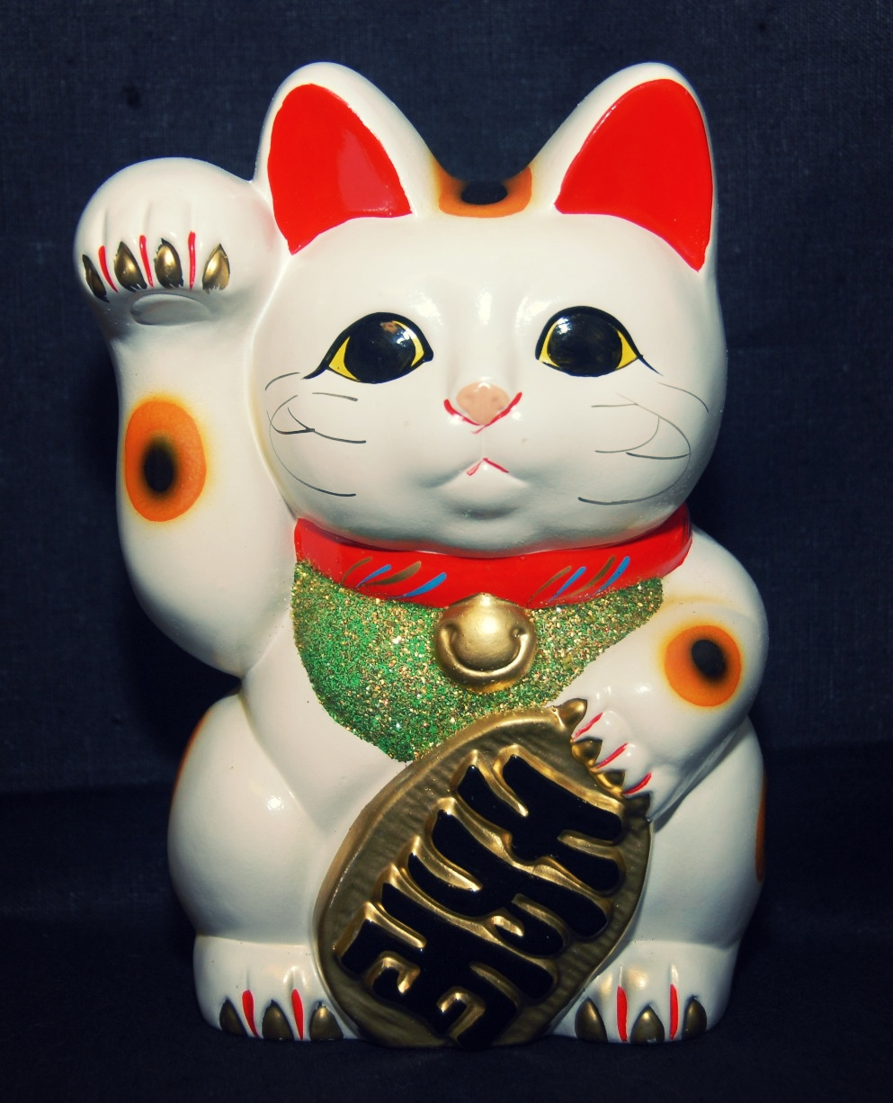 Maneki-neko toivottaa tervetulleeksi Japaniin.