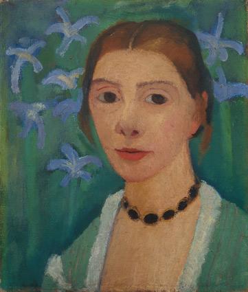 Selbstbildnis vor grünem Hintergrund mir blauer Iris, um 1905. Von Paula Modersohn-Becker (1876–1907).