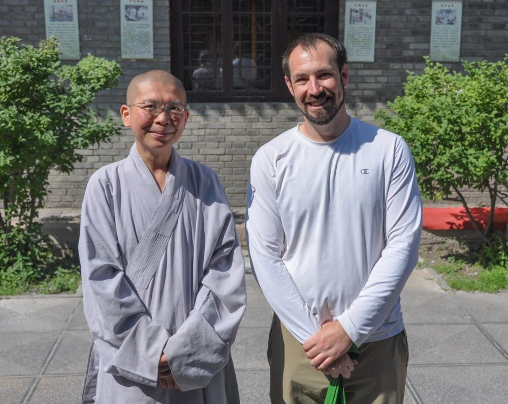 Justin Whitaker in Wutai Shan, China over the summer of 2016. While there at a religious festival he fortuitously met with Jin ho Shi (left), a Taiwanese nun who had studied alongside Justin in Bristol, England.