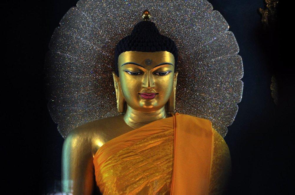 Buddha statue from the inner sanctum of the Mahabodhi Stupa.JPG