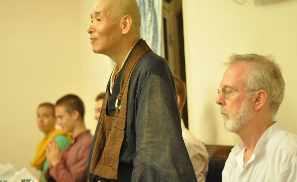 Ekai Koromatsu Osho leading prayer before dinner at Sujata Hotel.JPG