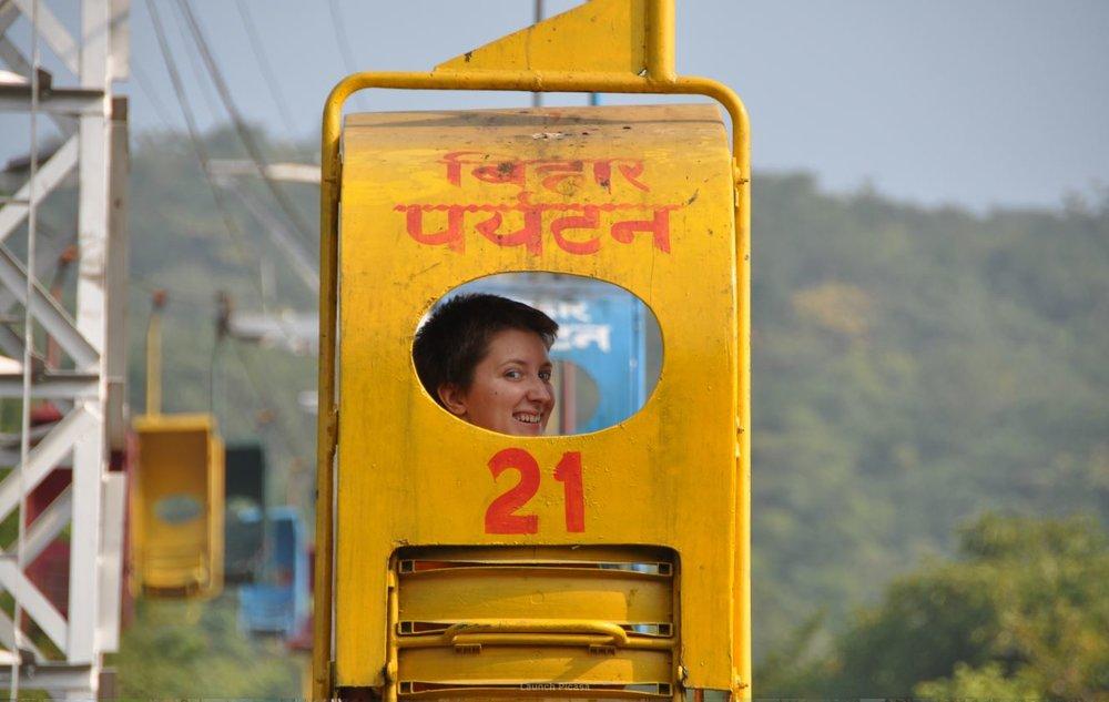 student in chair-lift to top of Vultures Peak, Rajgir.JPG