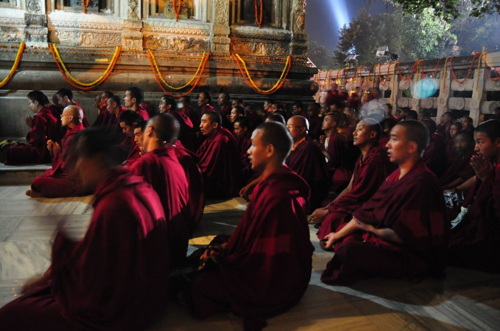 Tibetan monks chanting at the Bodhi Tree, Bodhgaya.JPG