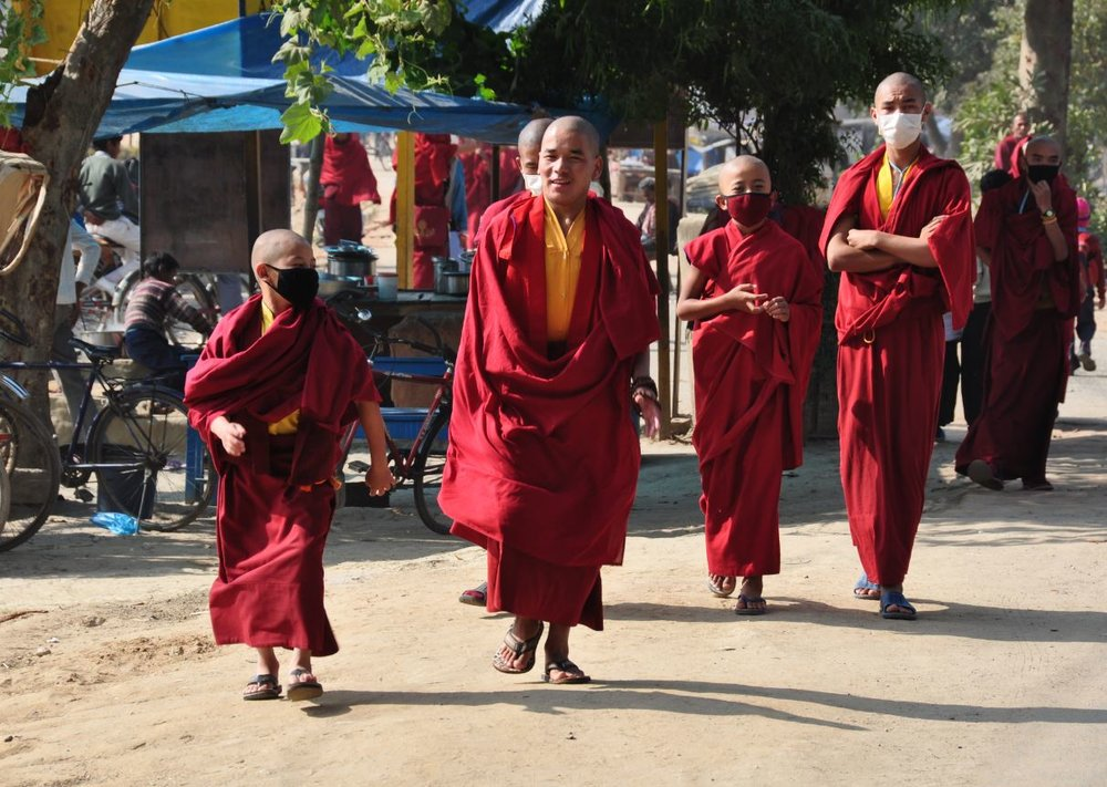 Tibetans walking the streets in Bodhgaya.JPG