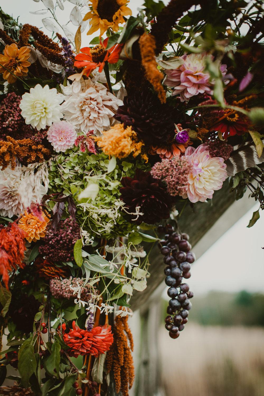 wedding arbor closeup local flowers