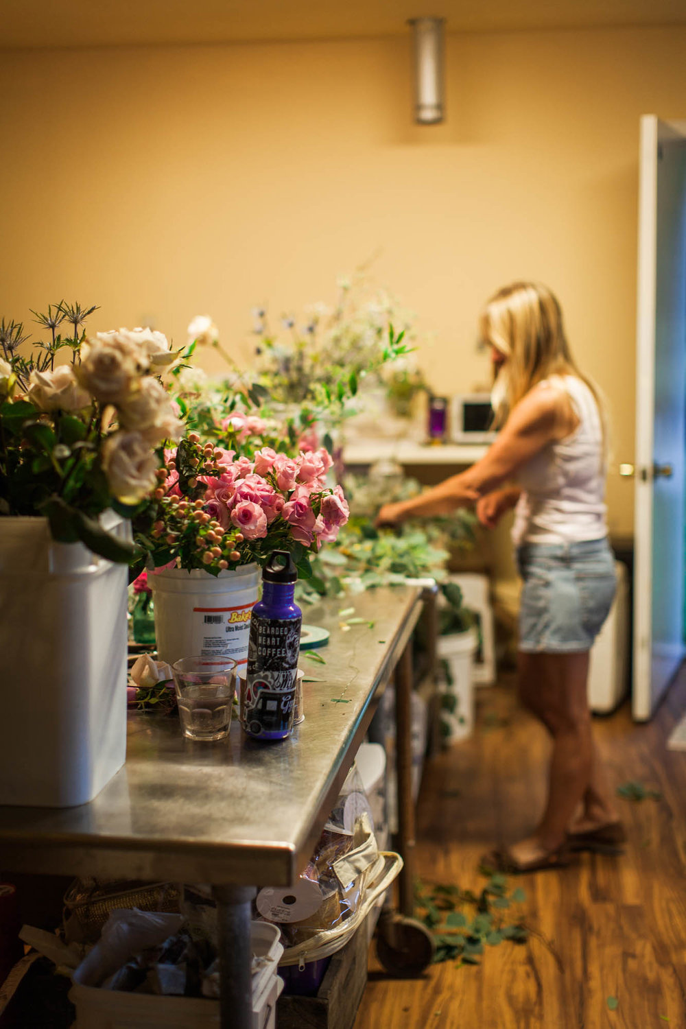 Granny Jo cleaning up after a long day of floral design in our Sister Bay workshop.  Photo Credit: Artemis Photography