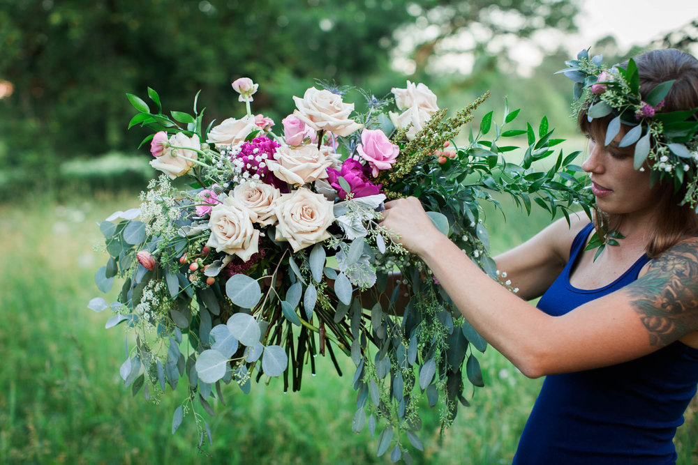 Here I am putting the finishing touches on a romantic, vintage, Shakespeare-inspired bridal bouquet.  Photo Credit: Artemis Photography