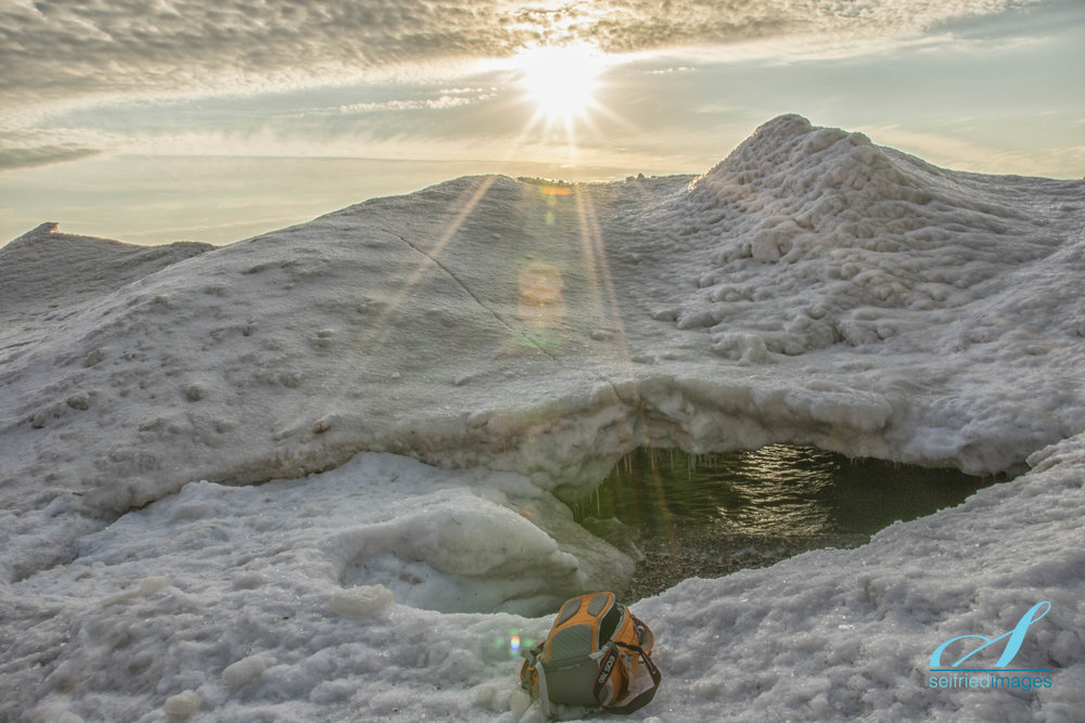 """My camera bag and the undermined """"mountain"""" where the  Ice Cave Lens Flare  image was created"""