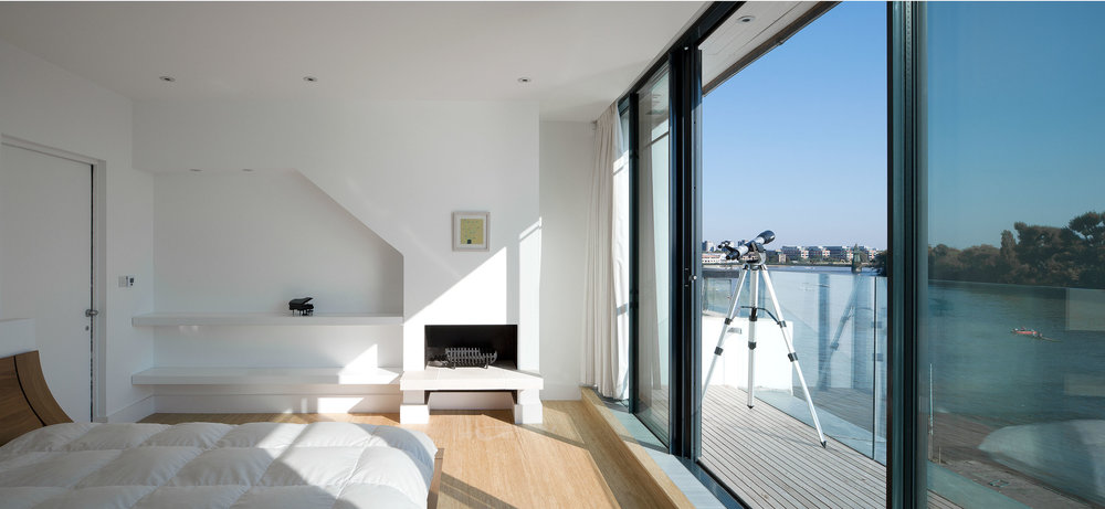 The master bedroom with a private balcoy overlooking the River Thames