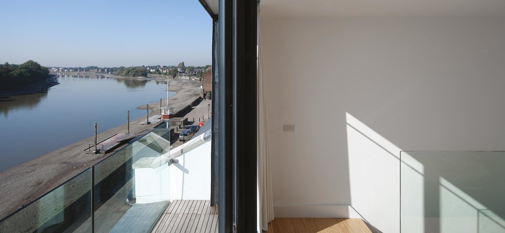 The master bedroom for the property with private balcony. The balcony has views along the River Thames