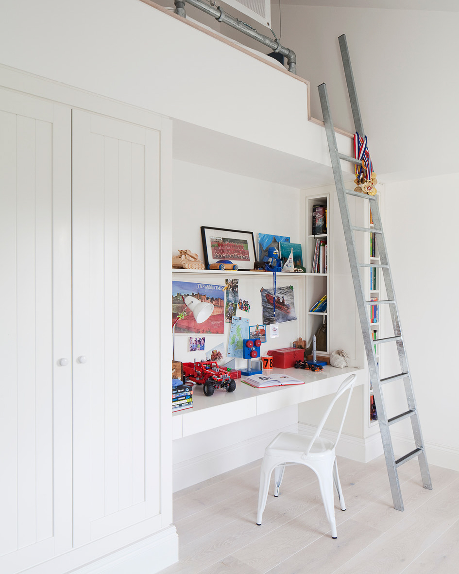 The children's bedroom. Bunk bed and sung accessed by a latter above a desk and wardrobe.
